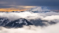 The Snowy Peak of Mount Rainier Towering Above the Clouds. Royalty Free Stock Photo