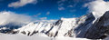 Snowy peaks panorama against the blue sky of austrian alps Stock Image