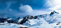 Snowy peaks panorama against the blue sky of austrian alps Royalty Free Stock Photo