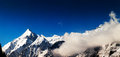Snowy peaks panorama against the blue sky of austrian alps Royalty Free Stock Photography
