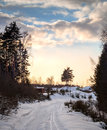 Snowy road cold winter village under evening cloudy sky karelia russia Stock Image