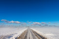 Snowy road in coutryside Stock Photography