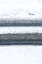 Snowy road tire tracks on asphalt Royalty Free Stock Photo