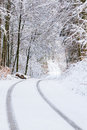 Snowy roads road coverd with snow in the forest Stock Photos