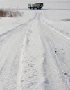 Snowy tracks with cement mixer Royalty Free Stock Photo