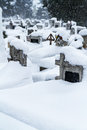 Snowy winter cemetery snowfall Royalty Free Stock Images
