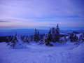 Snowy winter landscape in the mountains at dusk Royalty Free Stock Photo