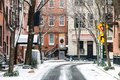 Snowy winter scene on Commerce Street in the Greenwich Village neighborhood of Manhattan in New York City Royalty Free Stock Photo