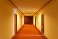 A snug corridor in the hotel with an opened door Stock Image