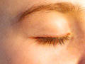 Soaking up the sun a close view of a teenage girls eye last rays of Stock Photography