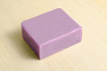 Soap bar flavor with lavender scent  on wooden board bac Royalty Free Stock Photo