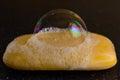 Soap bubble on black background Royalty Free Stock Image