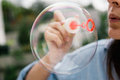Soap bubble detail of woman blowing bubbles Stock Photos