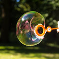 Soap bubble in park in summer Royalty Free Stock Photography