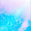 Soap bubbles on a blue sky background light Stock Images