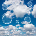 Soap bubbles on cloudy sky Royalty Free Stock Image