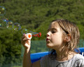 Soap bubbles little girl blowing Royalty Free Stock Image