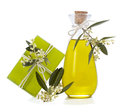Soap and olive oil with a sprig of blossoms ollive on white background Royalty Free Stock Photo