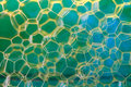 Soap suds extreme closeup creating multi layered pattern honeycomb on blurred background Stock Photo