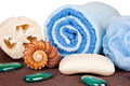 Soap, towel, loofah on mat Stock Photos