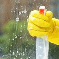 Soapy detergent on window glass during washing from spray bottle Stock Photo