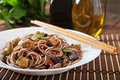 Soba noodles with eggplant in sweet and sour sauce Royalty Free Stock Images