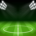 Soccer background with bright spot lights stadium Stock Photos