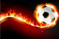 Soccer ball with abstract fire burning on a red background Stock Image