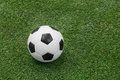 Soccer ball on artificial turf close up green grass or Stock Photography