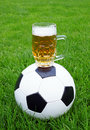 Soccer ball and beer mug Stock Images