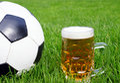 Soccer ball with beer mug Royalty Free Stock Photo