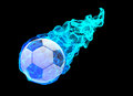 Soccer ball in blue energy flame a surrounded by a isolated on black Royalty Free Stock Photo