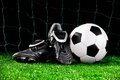 Soccer ball and cleats Stock Photography