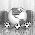 Soccer ball with earth Stock Photos