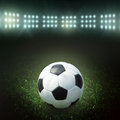 Soccer ball on the field of stadium with light Royalty Free Stock Photography