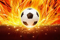 Soccer ball in fire abstract sports background burning flame Stock Images