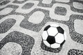 Soccer ball football ipanema rio de janeiro brazil sits on sidewalk at Stock Photo