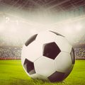 Soccer ball or football on stadium warm colors toned Stock Photos