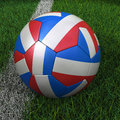 Soccer ball with french flag d france on green field Royalty Free Stock Photography