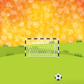 Soccer ball and gate with sunset background Royalty Free Stock Photo