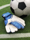 Soccer ball and gloves Royalty Free Stock Photography