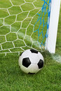 Soccer ball in goal net Royalty Free Stock Image