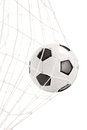 Soccer ball in a goal net isolated on white background Stock Photography