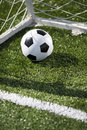 Soccer ball and goal net selective focus Stock Photo