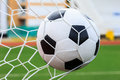 Soccer ball in goal net winner concept Royalty Free Stock Photography