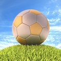 Soccer ball gold silver on the grass with clipping path on the Stock Images