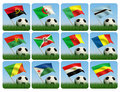 Soccer ball in the grass. African flags. 3d Stock Photos