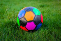 Soccer ball on grass color green Royalty Free Stock Images