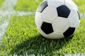 Soccer ball on grass in corner kick position on soccer field stadium Royalty Free Stock Photo