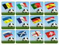 Soccer ball in the grass and the flag Royalty Free Stock Image